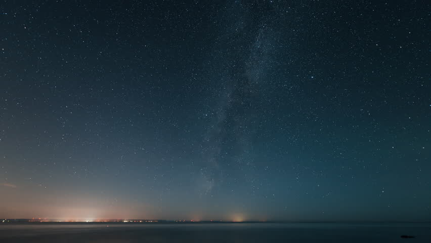 4K time lapse sequence of a starry night with the Milky Way with Perseid meteor shower transitioning into dawn over Georgian Bay, Ontario, Canada.