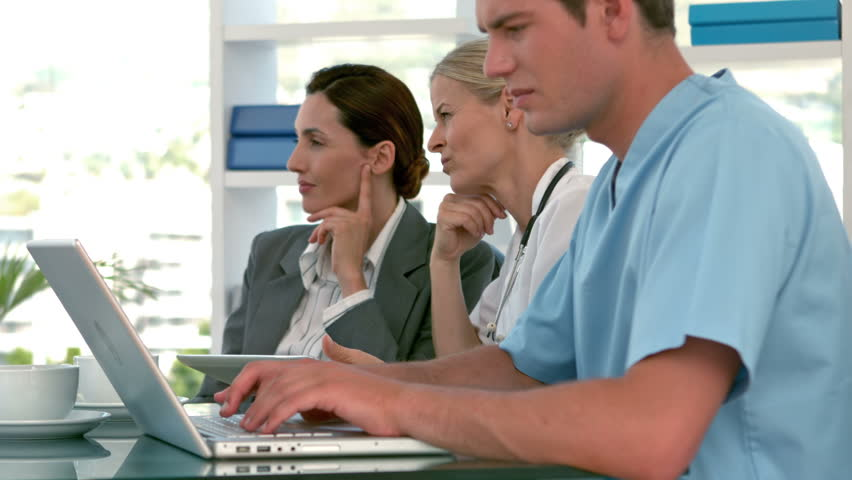 Doctors speaking with business team during meeting in slow motion | Shutterstock HD Video #11459507