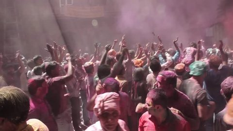 Holi festival is carnival of colours, where participants play, chase and colour each other with dry powder and coloured water. Location - Banke Bihari Temple, Vrindavan,  India, March 2014