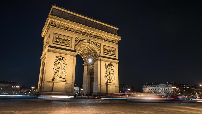 A Time Lapse of the of the Arch of Triumph (Arc de Triomphe) by night, with cars and buses passing by with motion blur.  | Shutterstock HD Video #11469947