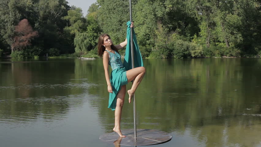 Girl does exercises on a pylon. She is dancing. | Shutterstock HD Video #11485328