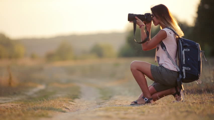 Beautiful Young Woman Journalist In The Steppe. Girl With Camera ...