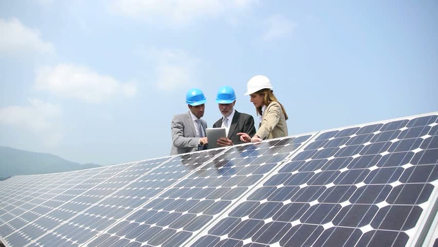 Engineers checking solar panels setup