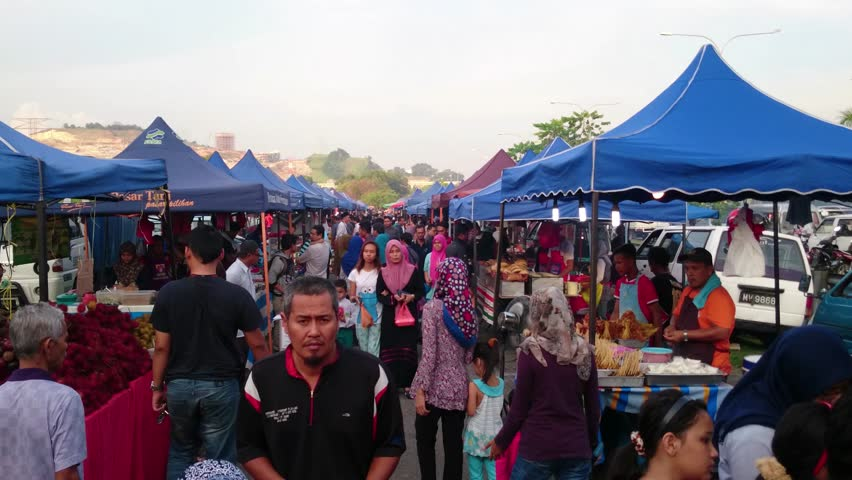 """KUALA LUMPUR, MALAYSIA- August 17 2015: Shoppers throng the Malaysian """"Pasar Malam"""" or night market. Night market is popular among Malaysian as it offers cheap and convenient mode of shopping."""