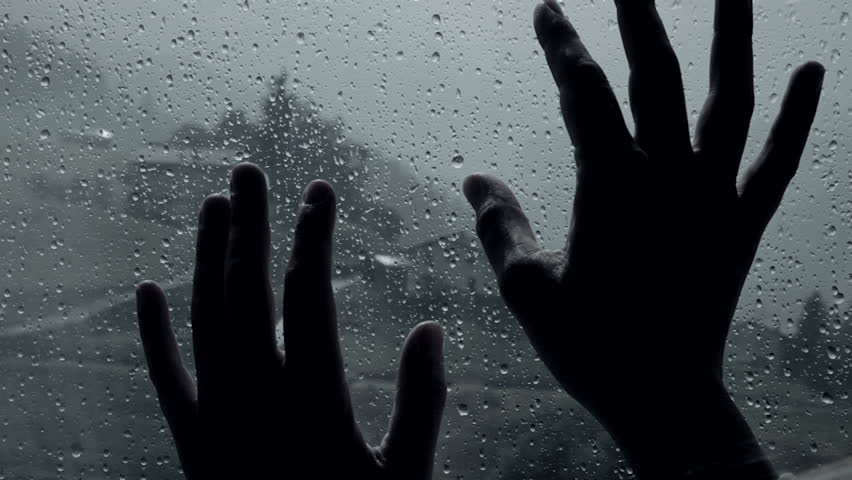 Hands in front of rain dramatic concept