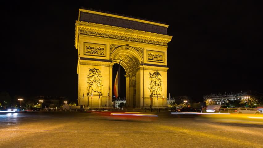 France, Paris, Etoile, French flag under Arc de Triomphe built by Napoleon - timelapse   Shutterstock HD Video #11604755
