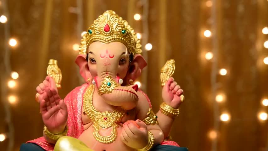 Pen Ganesh Murtidownload Hd: Ganesha- A Statue Of An Indian God Against Blinking