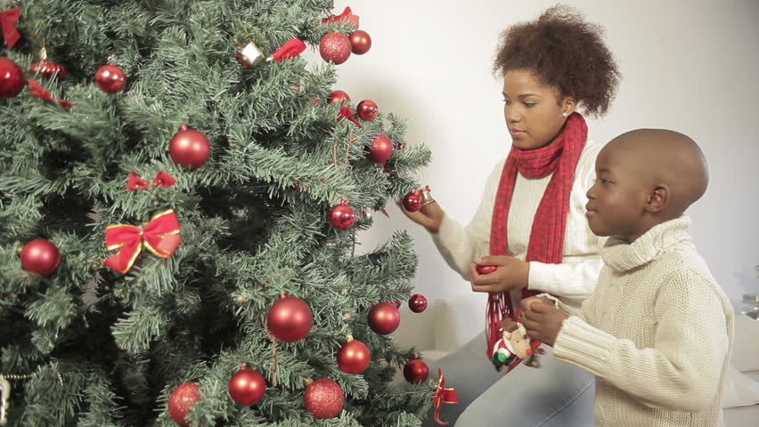 Superior Family Around Christmas Tree Part - 12: Black Boy With His Mother Decorating The Christmas Tree - HD Stock Video  Clip