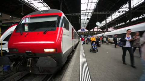 BASEL, SWITZERLAND - CIRCA MAY 2015: Walk into a train at the main train station of Basel city. Located where the Swiss, French and German borders meet, Basel also has suburbs in France and Germany.