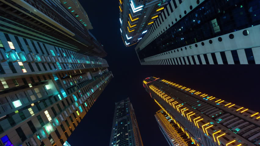 Dubai city night illumination apartment buildings up view 4k time lapse uae