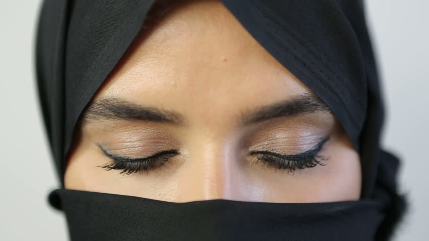 The eyes of an Arab woman show through her black abaya.