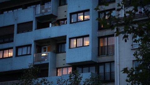 abstract apartment building establishing shot at night