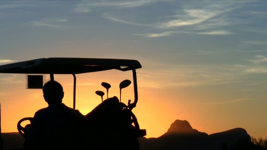 Golf cart silhouette at sunset close-up