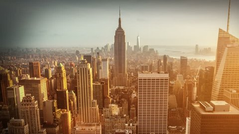 NEW YORK CITY - April 14, 2014: Aerial view of Manhattan skyline during dusk. Zoom in. Sunset. Vintage. Time lapsed view of the famous New York buildings.