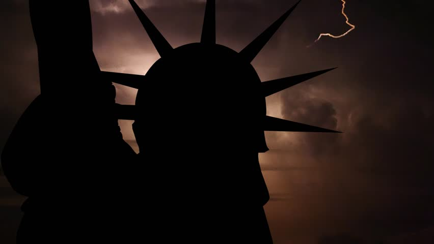International political, financial and economic crisis,world war, military, apocalypse concept. Loopable video. Silhouette of USA Statue of Liberty on dark background with flashing lightning storm.