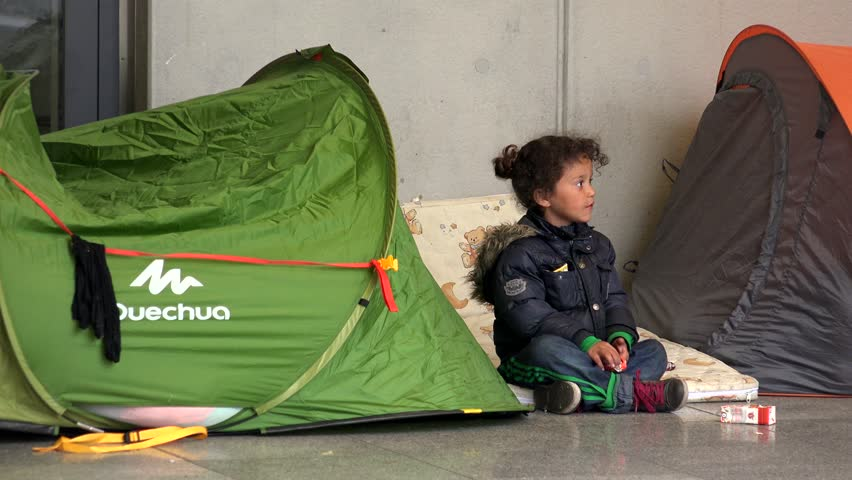 BUDAPEST, HUNGARY - AUTUMN 2015: Children of immigrants and refugees at the railway station in Budapest. Shot in 4K (ultra-high definition (UHD)).