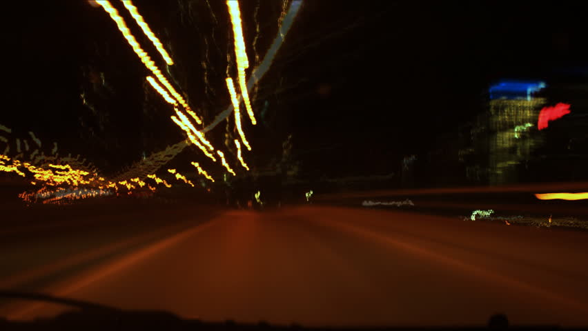 Hyper night drive. Timelapse clip assembled from photographic stills. Highway driving with a quick turnaround at an exit. All logos removed and/or blurred. QEW highway. Toronto, Ontario, Canada