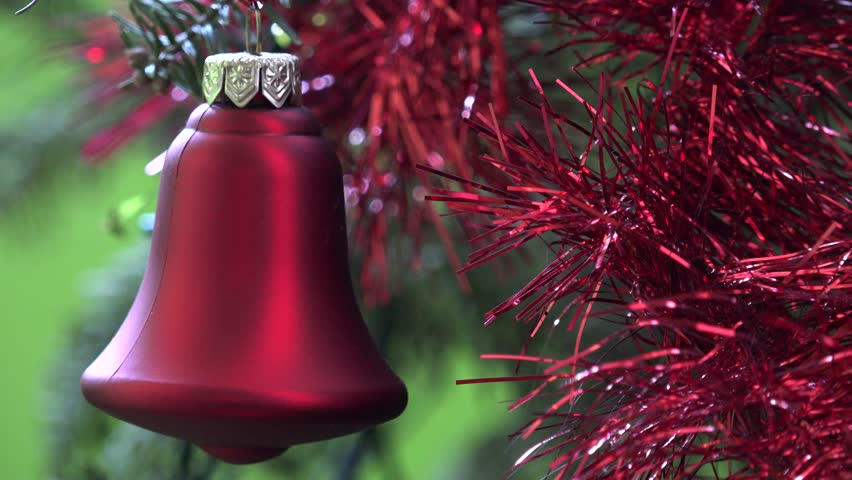 4K Closeup of Christmas red bell decoration, Xmas celebration in interior of festive home by day #11760416