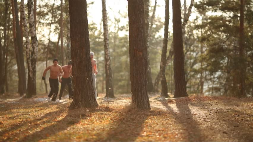 Six Half-Naked Young Men Run In Forest Near Lake At Autumn Stock Footage Video -5787