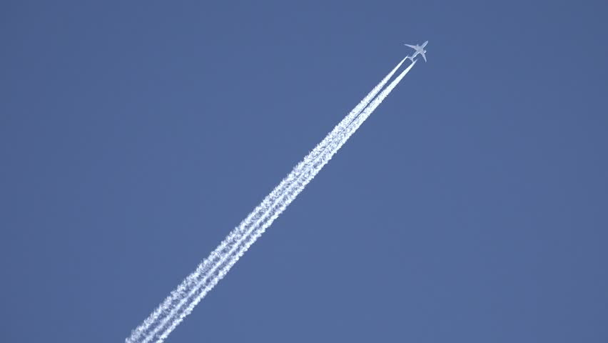 4K View of Airplane jet layer, aircraft pollution on sky, white trace vapour by day