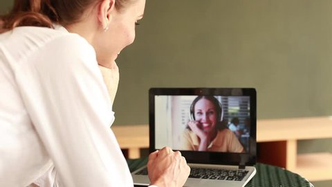 woman talking to a friend on video call