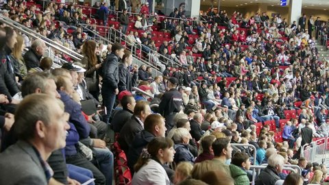 Chelyabinsk, Russia - September 19, 2015: Fans happily respond to the goal scored in the hockey game.