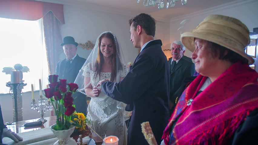 The registrar arrives to the table, says to the young couple and all the guests to stand up and the service will begin. The room is beautifully decorated.  | Shutterstock HD Video #11847707