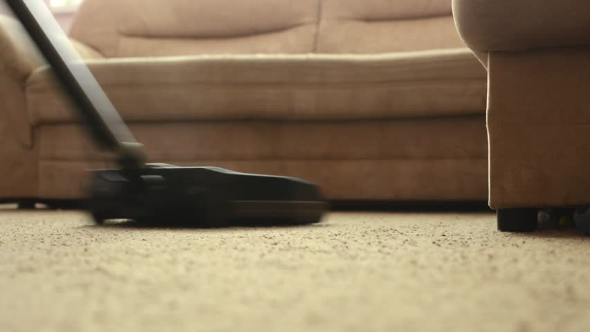 Awesome Man Cleans Carpet With Vacuum Cleaner Before Couch   Close Up   Detail