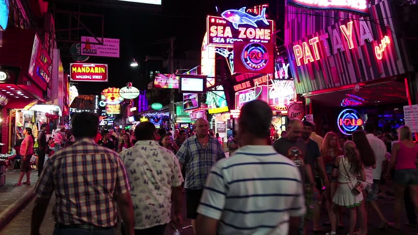THAILAND, PATTAYA, MARCH 31, 2014: Walking Street is red-light district with many restaurants, go-go bars and brothels, that draws people, primarily for night life and sexual entertainments