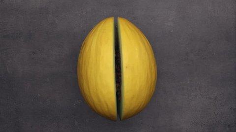 Cutting yellow honeydew melon