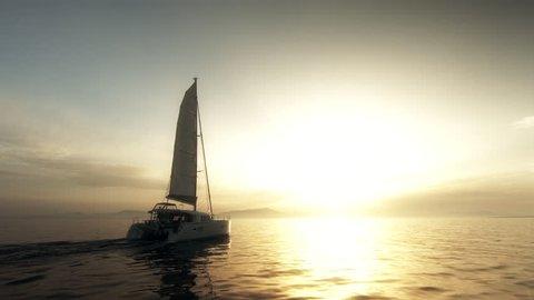 Catamaran Sailing Towards The Sun