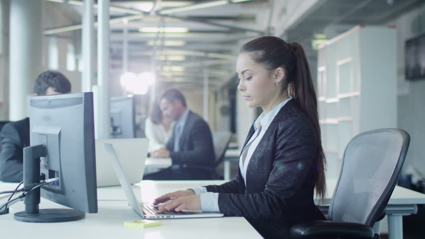 Female Office Worker is Working on Computer. Shot on RED Cinema Camera in 4K (UHD). | Shutterstock HD Video #11956637