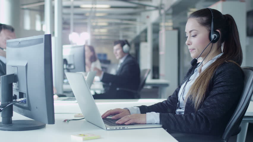 Customer Support Workers are Working in Call Center. Shot on RED Cinema Camera in 4K (UHD).