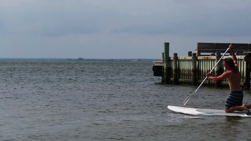 ... Young fit male on stand up paddle board. SUP surfboard. Long Beach  Island ... 58e6574da