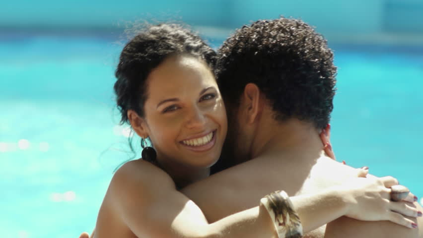 Honeymoon and people, happy young newlyweds smiling and relaxing near hotel swimming pool, husband and wife on vacation, boyfriend and girlfriend during holidays