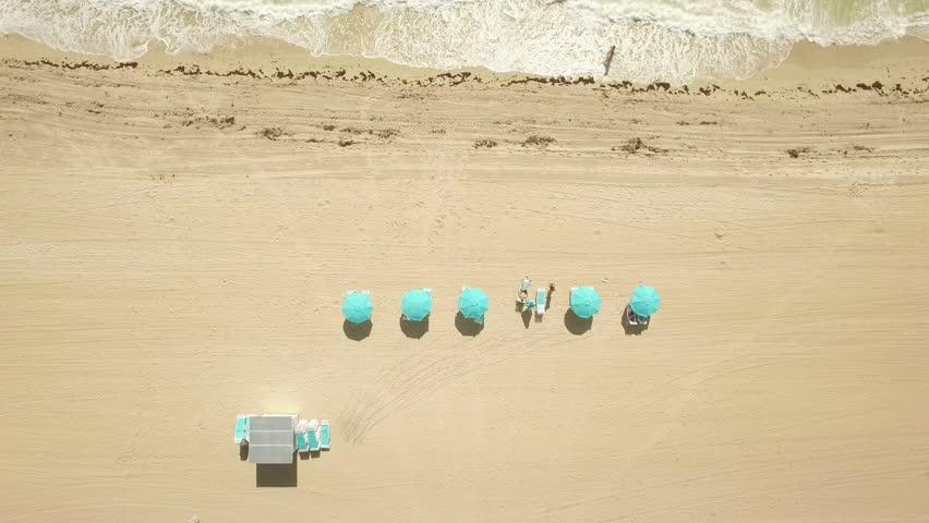 Aerial spin video of the sands of Miami Beach, Florida. 4K Ultra HD video, DJI Phantom 3 pro. | Shutterstock HD Video #11999867