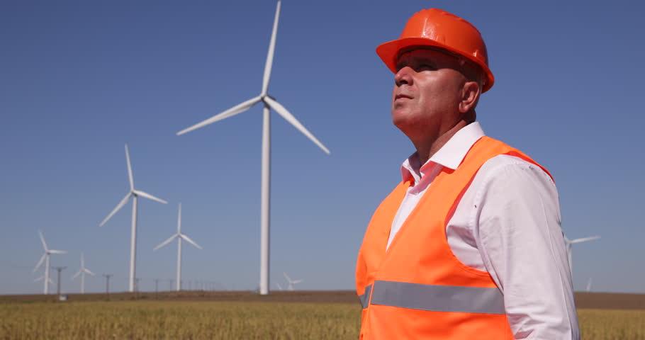 Stock Video Clip Of Foreman Walk Wind Turbines Farm Looking Activity |  Shutterstock