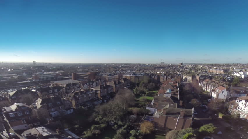 Flying above London houses in suburb area