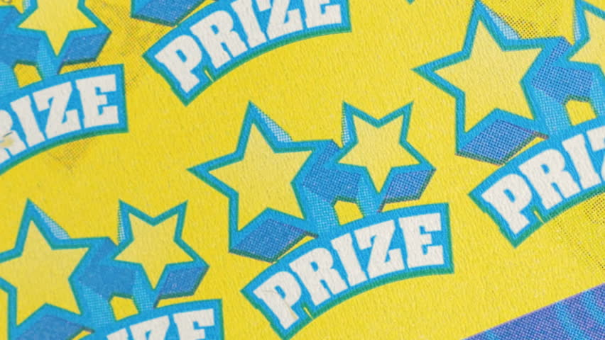 BOSTON, MA - OCT 4, 2015: Playing scratch and win instant lottery ticket on October 4, 2015. Massachusetts became the first state to offer an instant lottery game using scratch-off gambling tickets.