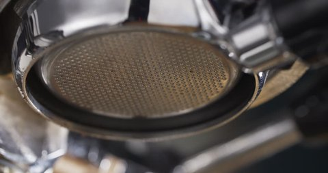 coffee extraction with bottomless portafilter on professional espresso machine, 4k prores footage