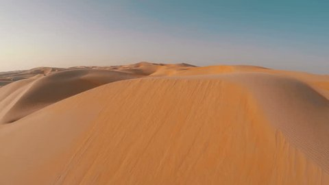 Drone shot flying close over sand dune
