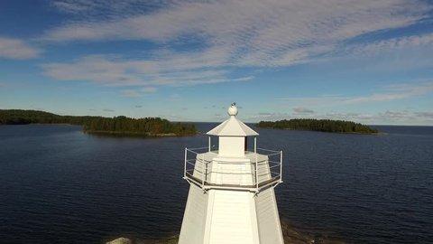 Reveal Shot of Lake Vaner, Sweden, Emerging Behind Historic Wooden Lighthouse