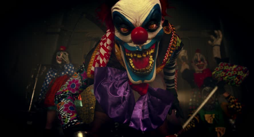 Party of clowns. Clowns dancing and intimidating weapons. Halloween. | Shutterstock HD Video #12106685