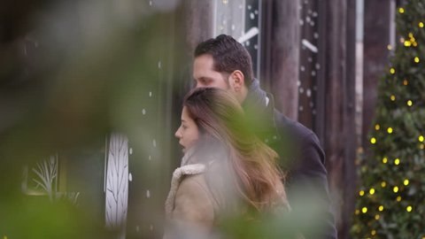 4K Attractive romantic couple shopping together at Christmas time. Shot on RED Epic.