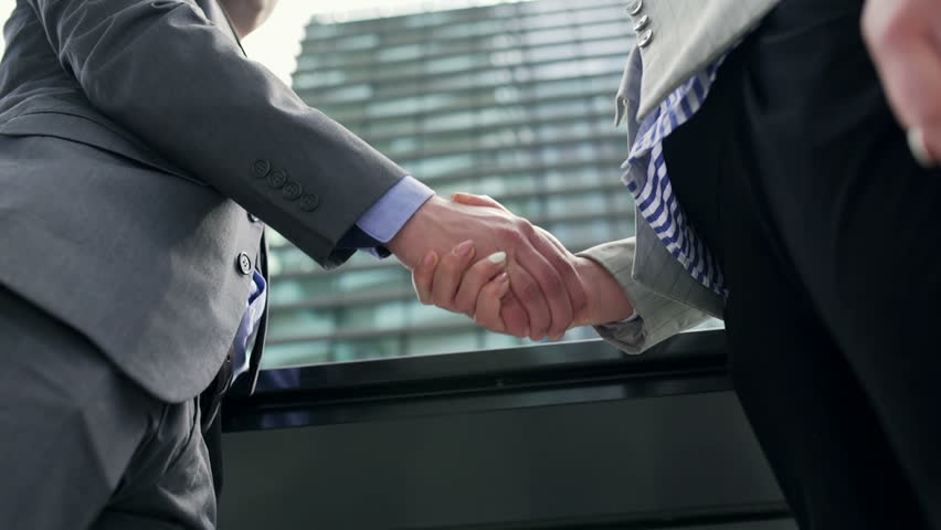 Businesspeople shaking hands because of the agreement, steadycam shot  | Shutterstock HD Video #12107687