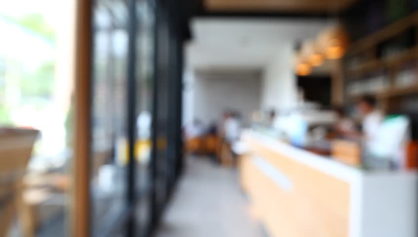 Blurred background of Coffee shop interior counter