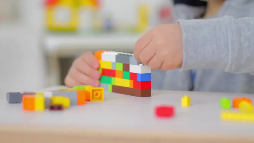 Orvieto, Italy - March 9th 2015: child playing with lego bricks, close up. Lego is a popular line of construction toys manufactured by the Lego Group