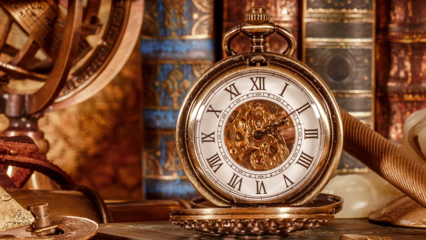 Vintage antique pocket watch on the background of old books stock vintage book compass telescope and a pocket watch lying on ancient world map in gumiabroncs Choice Image
