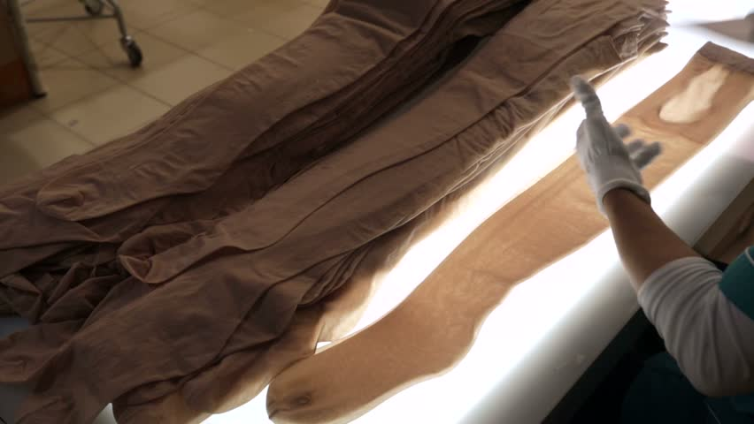 On the production line, worker package new women's pantyhose.