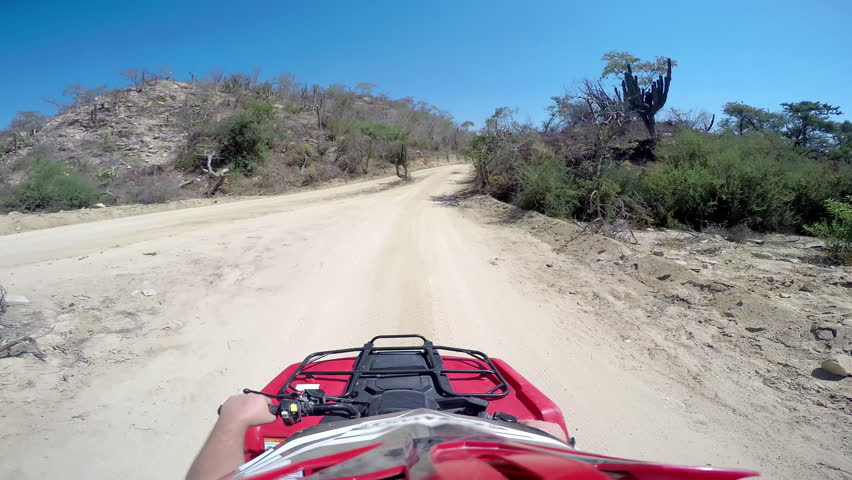 First person POV of a four wheeler driving on trails at the coast | Shutterstock HD Video #12179027
